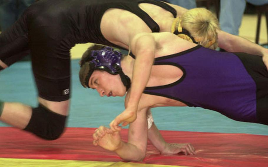 Würzburg's Jesse Painter (right) tries to get away from Patch's Joe Morrow during their 125-pound winner's bracket semifinal match at the Wolfpack Holiday Classic '03 at the Kessler Fitness Center in Schweinfurt, Germany. Morrow won the match, 7-6.