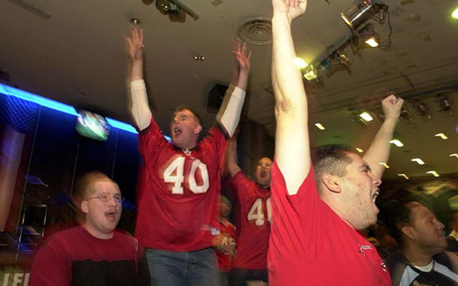 Tampa Bay Buccaneer fans rejoice while watching the Super Bowl at Club Trilogy on Monday.