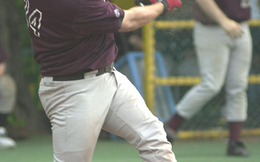 Left-fielder Anthony Salas of Zama American connects on a second-inning grand slam home run during the opener of Tuesday's Kanto Plain Association of Secondary Schools doubleheader at St. Mary's International School in southwest Tokyo.