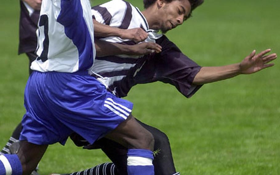 Hohenfels' Fredner Reserve, left, and Baumholder's Rios Harvey fight for a loose ball during a DODDS high school soccer game in Baumholder, Germany, on Saturday.