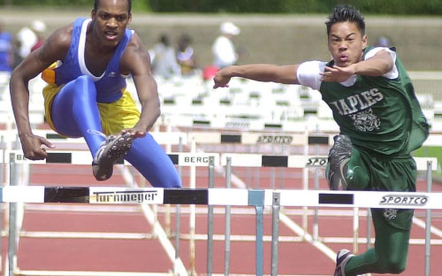 Ansbach's Jonathan Austin, left, and Naples' Nate Tenorio are dead even as they leap over the final hurdle during the 110-meter hurdles at the DODDS Division I Track and Field Championships in Wiesbaden, Germany, on Saturday.