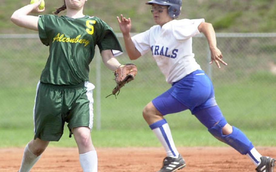 Alconbury's Alicia Christensen, left, fields a ground ball and throws to first as Rota's Karen O'Neal advances to third during the DODDS Division III high school softball championships in Landstuhl, Germany, on Saturday.