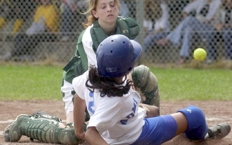 Rota's Crystal Mirales slides safely into home as Alconbury catcher Ashley Roy reaches for the ball during the DODDS Division III high school softball championships in Landstuhl, Germany, on Saturday.