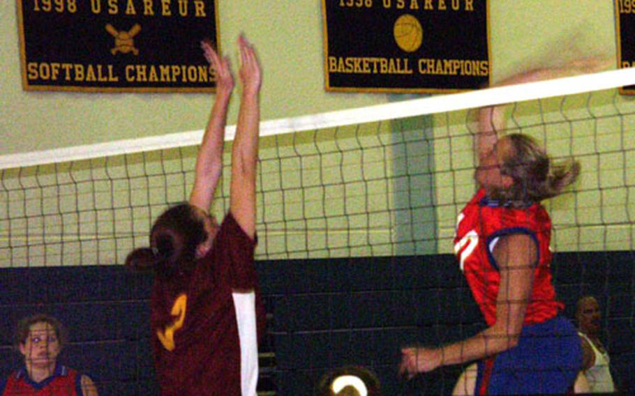Bamberg's Debra McNamara generates some arm speed as she makes a kill over Vicenza's Candida Kilgore during Bamberg's 25-15, 25-17 pool-play victory Friday in the 2003 Army-Europe volleyball tournament at Patton Barracks in Heidelberg. The tournament continues through Sunday.