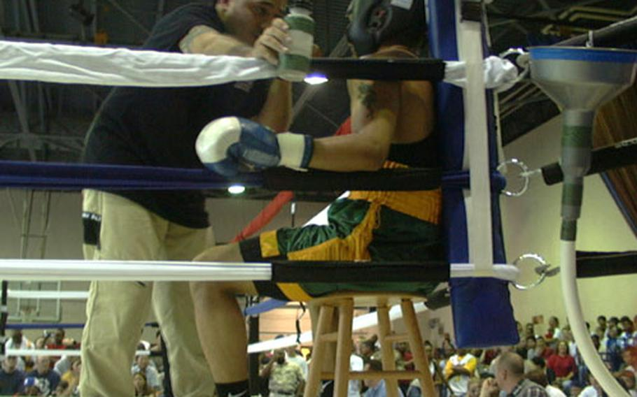 Between rounds during the July 4th Army boxing card at Camp Walker in Taegu, South Korea, Taegu fight coach Miguel Marquez gives ring advice to his fighter, Sgt. Robert Flores of 728th Military Police Battalion.
