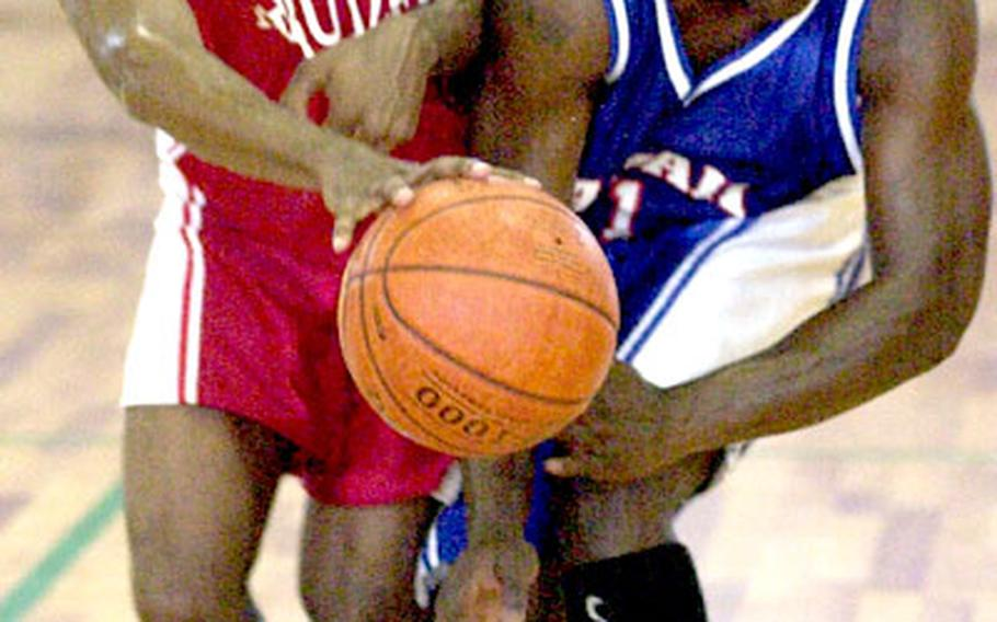 Jack Kennedy, left, of Marine Corps Base Camp Butler and Takarron Perry of Marine Corps Base Hawaii battle for the ball during Tuesday's game in which Hawaii routed Base 115-79.