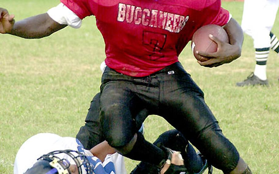 Kadena Buccaneers senior A.J. Morgan (with ball) has 487 all-purpose yards and 5 TDs in the past two games.