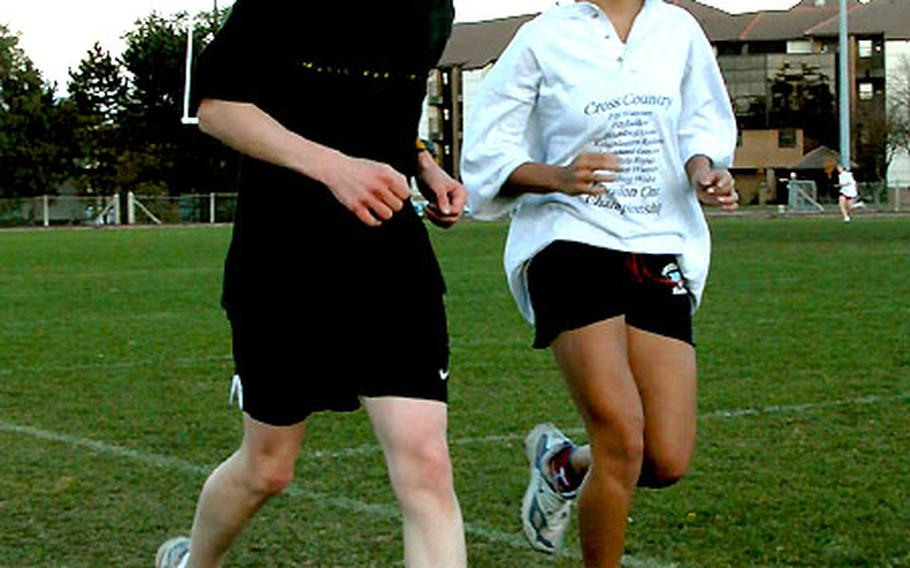 Greg Billington, left, and Frankie Houck of Lakenheath High School are the top runners on the Lancers cross country team. Both have competed in mini-triathlons.