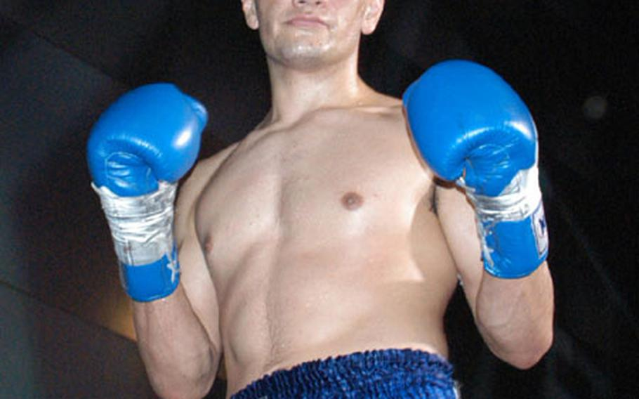 Senior Airman David Archuletta poses after his Jan. 24 victory in Tokyo.