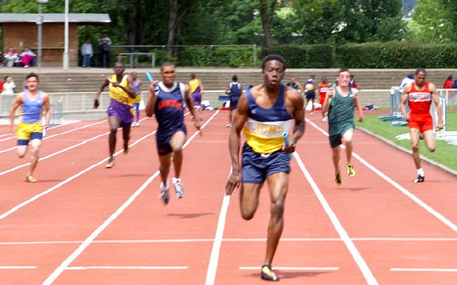 Nate Idlet of Heidelberg High School crosses the finish line during the boys 4x100 meter relay. The team, made up of Idlet, DJ Johnson, Brandon Grant and Sean Tucker, won in a combined time of 44.32.