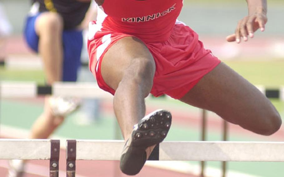 Senior Brenden Lynce of Japan's Nile C. Kinnick Red Devils runs the 110 high hurdles during Saturday's Kanto Plain Association of Secondary Schools track and field championship at Oi Pier Ground, Tokyo.