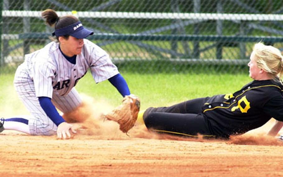 Patch's Marilyn Martin (right) slides into third under the tag by Bitburg's Monica Bintz during Saturday's DODDS Division II European softball championship.