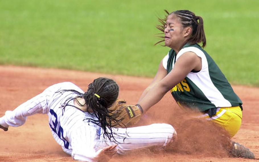 London Central Ashley Willis (left) slides into second under the tag of Alconbury's Jannel Acaba during Saturday's DODDS Division III European softball championship game in Ramstein, Germany.
