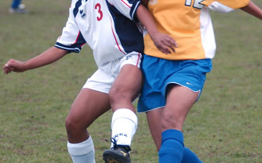 Aviano's Kasie Mangosing, left, wrestles the ball away from Ansbach's Kate Alegado in the DODDS European Division III Women's Soccer Championship in Kaiserslautern, Germany, on Friday.