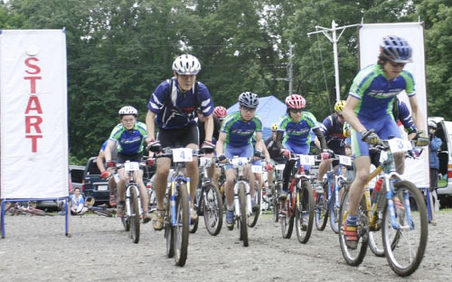 Mountain bike racers in the 14th Tour De Tama bike race shuffle for position Saturday at the Tama Hills Recreation Center, Japan. More than 70 American and Japanese riders took on the challenge of the steep muddy course for awards and prizes.