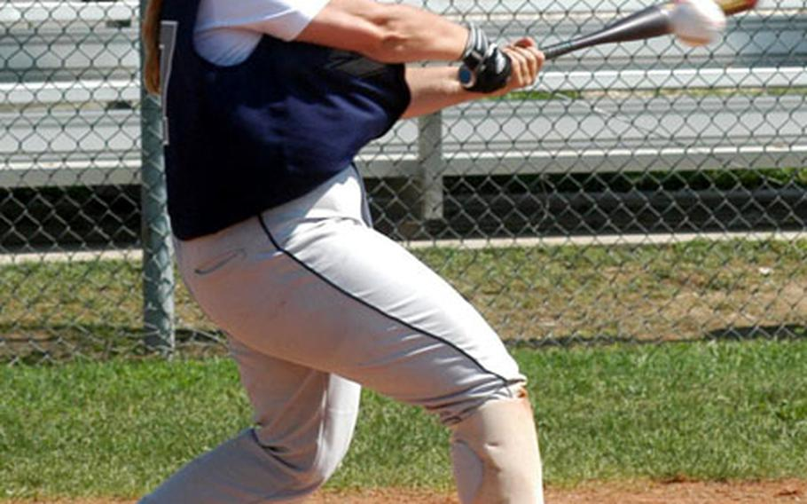 Lakenheath's Kathy Trim drills a base hit during Thursday's championship game of the U.S. Air Forces in Europe women's softball tournament. Ramstein won the game, 9-5.