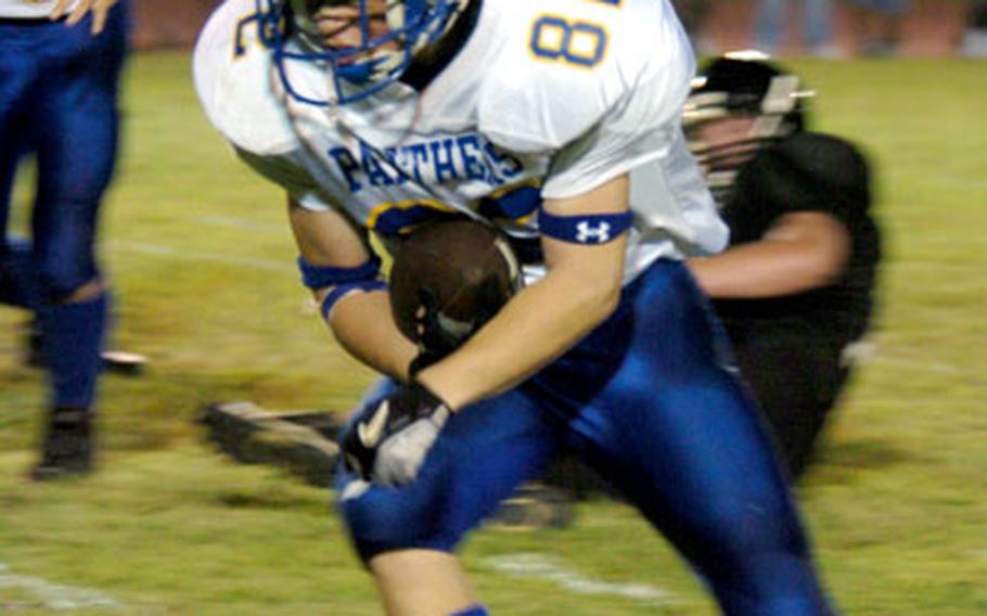 Yokota's Justin Hudson steps across the touchdown line for the evening's second touchdown.