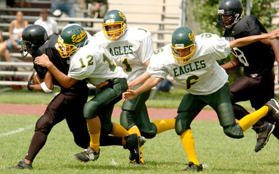A Zama Trojan is tackled by Edgren players.