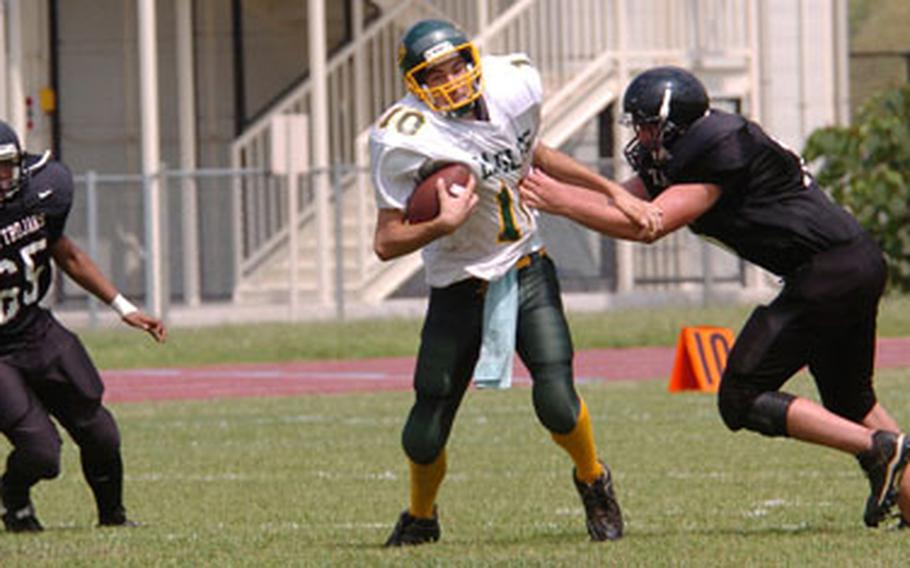 Edgren quarterback Josh Ray evades two Zama defenders.