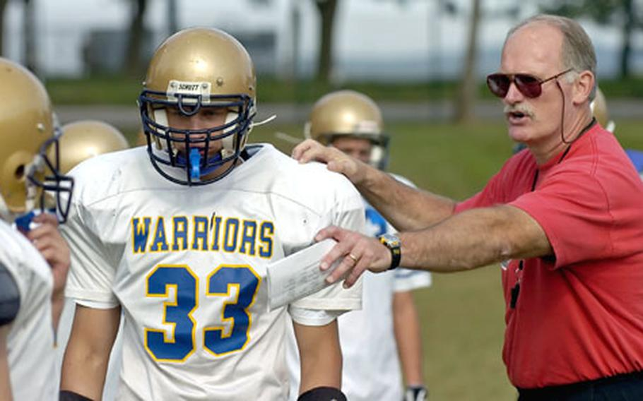 Wiesbaden assistant coach John Ewald directs Chase Socha and the defense during practice Tuesday in Wiesbaden, Germany.