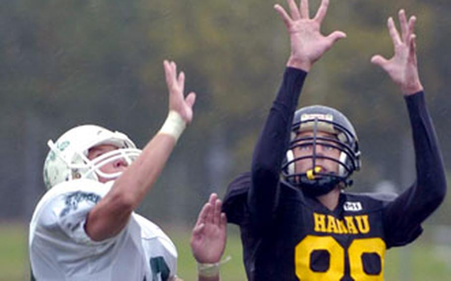 Hanau's T.J. Shulson, right, hauls in a pass over Naples' Will Carrico on Saturday.