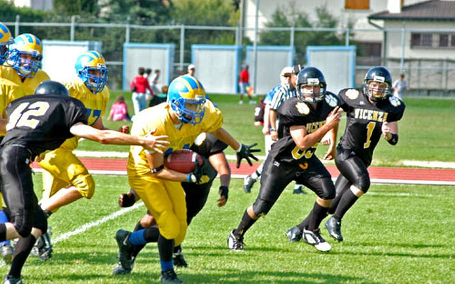 Running back Charles Melton, who spent a lot of time Saturday taking snaps as Ansbach's backup quarterback, breaks through the Vicenza defense for a big gain.