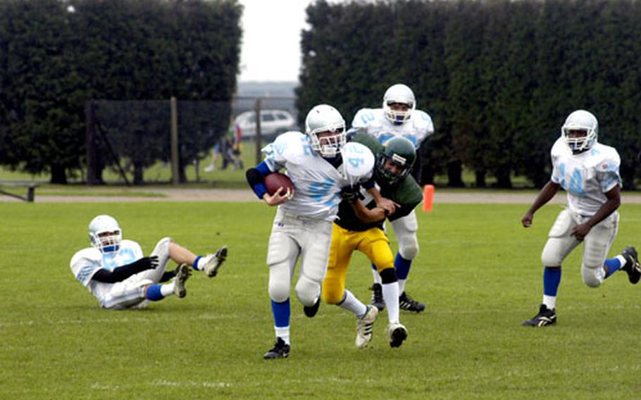 Alconbury's Andrew Hunt tries to pull down Brussels' Kevin LaBelle in the first half.