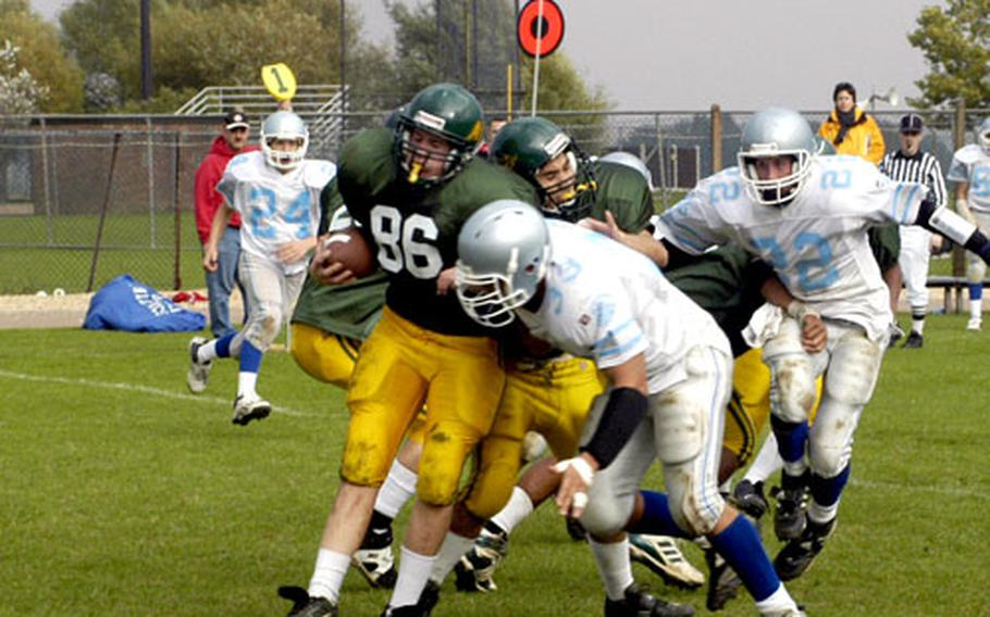Alconbury Dragons' Alex Davis is gang-tackled by Brussels defenders.