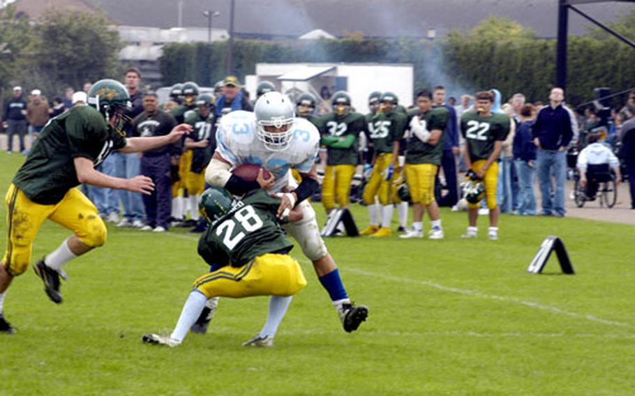 Alconbury's Dominick Sherenco hits Brussels ball carrier Eric Popp in the first half.