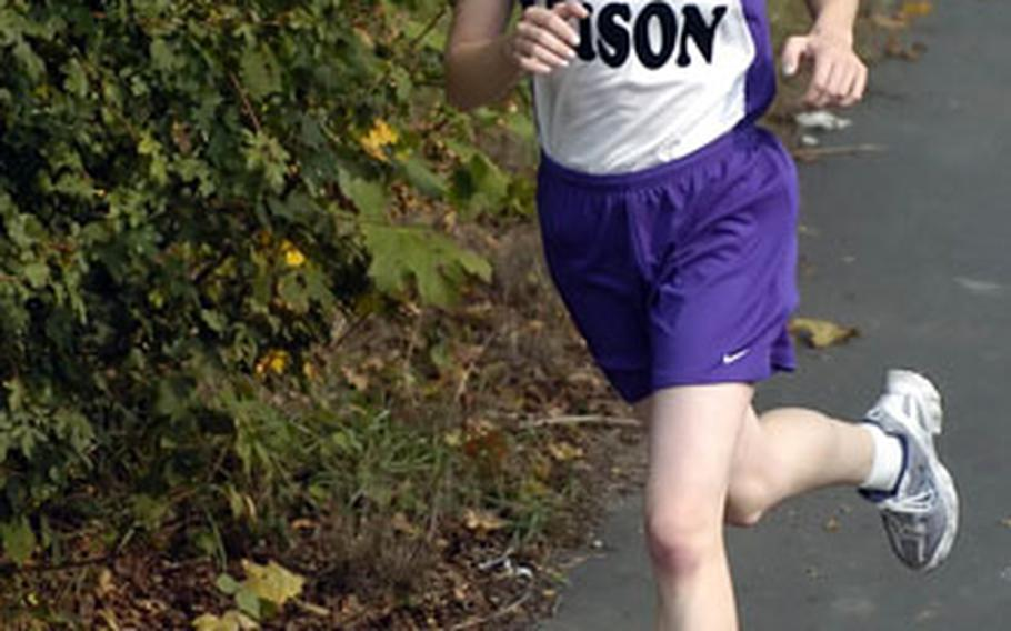 Mannheim's Bethany Johnston is on her way to a first-place finish at a DODDS high school cross country meet in Wiesbaden, Germany, on Saturday. Johnston won with a time of 21:18.