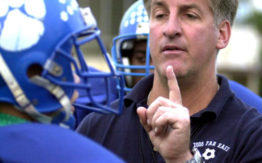 Yokota Panthers seventh-year head coach Tim Pujol makes a point to junior quarterback Tom Gass during a Wednesday workout. The Panthers fete their 30th anniversary homecoming on Friday when they host Robert D. Edgren.