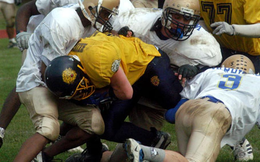 Heidelberg running back Andrew Spellman gets tackled by the Wiesbaden defense Saturday during the fourth quarter of Wiesbaden's 14-13 victory in Heidelberg, Germany.