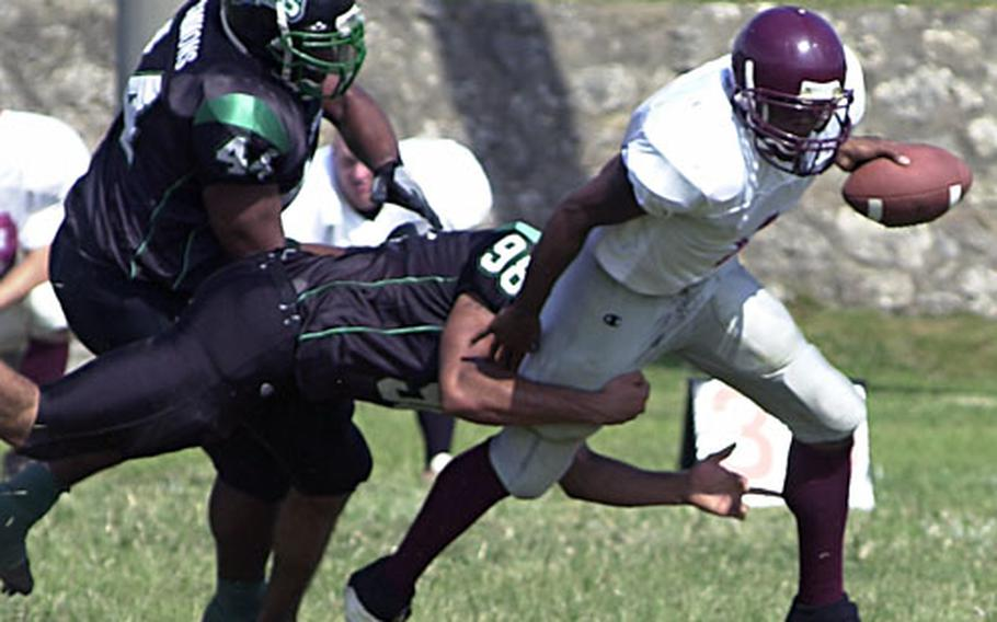 Kadena Dragons defensive end Kevin Carter (98) racks up one of his four sacks of Kinser Knights quarterback Jacksby Sewell during Sunday's OFL game at Camp Courtney, Okinawa.