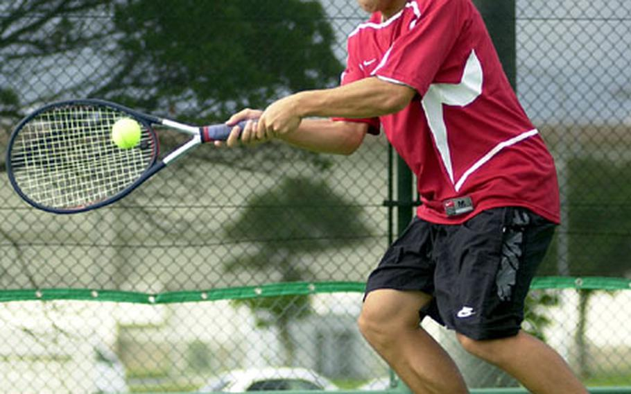 Kadena Panthers senior Anthony Soroka lunges to make a two-handed forehand shot against Bryan Garcia of the Kubasaki Dragons during Thursday's first singles match in the 2005 Okinawa Activities Council all-island tennis championships at Kadena Air Base. Soroka capped an unbeaten singles season by beating Garcia 6-1.