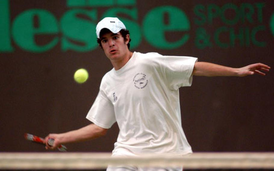 SHAPE's Claudio Giraldi has his eyes on a shot from Heidelberg's Mike Sanchez in the DODDS-Europe boys tennis title match in Wiesbaden on Saturday. Giraldi, the top seed, beat No.2 Sanchez 6-2, 6-3.