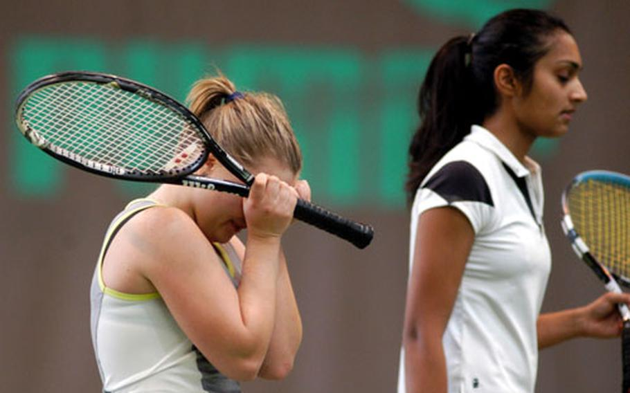 SHAPE's Krista Citkovska, left, can't hold back her emotions after defeating Milan's Shivani Saxena, right, 6-4, 6-4, to capture the DODDS-Europe girls' tennis crown.