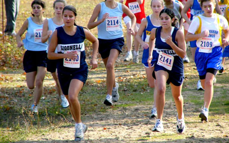 Sigonella's Ericka Anderson, left front, and her teammate Sammantha Boos took the lead from the outset of the European Small Schools girls cross country championship race.