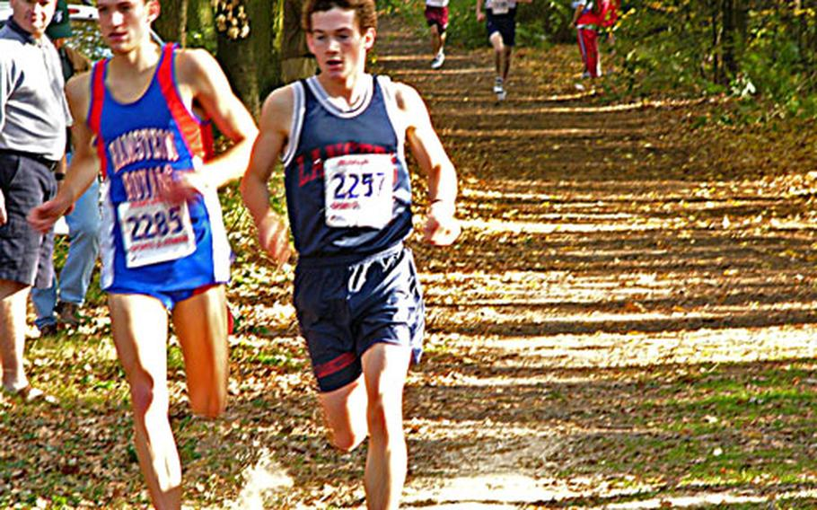 Lakenheath's Greg Billington, right, stays just ahead of defending champion Danny Edwards of Ramstein Saturday during the European Big Schools championship cross country race Saturday.