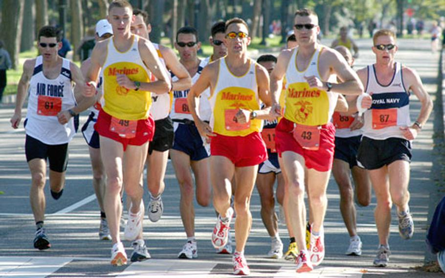 U.S. Marine Corps runners Jeremy Brown (49), William Edwards (41) and Alexander Netherington lead a pack of runners about 14½ miles into Sunday's Marine Corps Marathon. Brown finished 16th overall; Netherington was 17th and Edwards 18th.