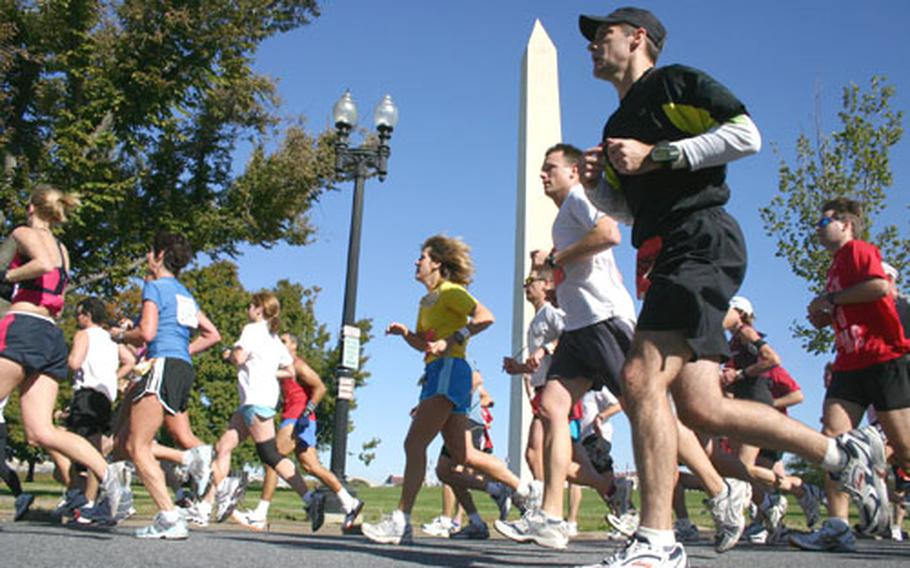 Runners in Sunday's Marine Corps Marathon in Washington, D.C. pass the Washington Monument as they approach the 14-mile mark.