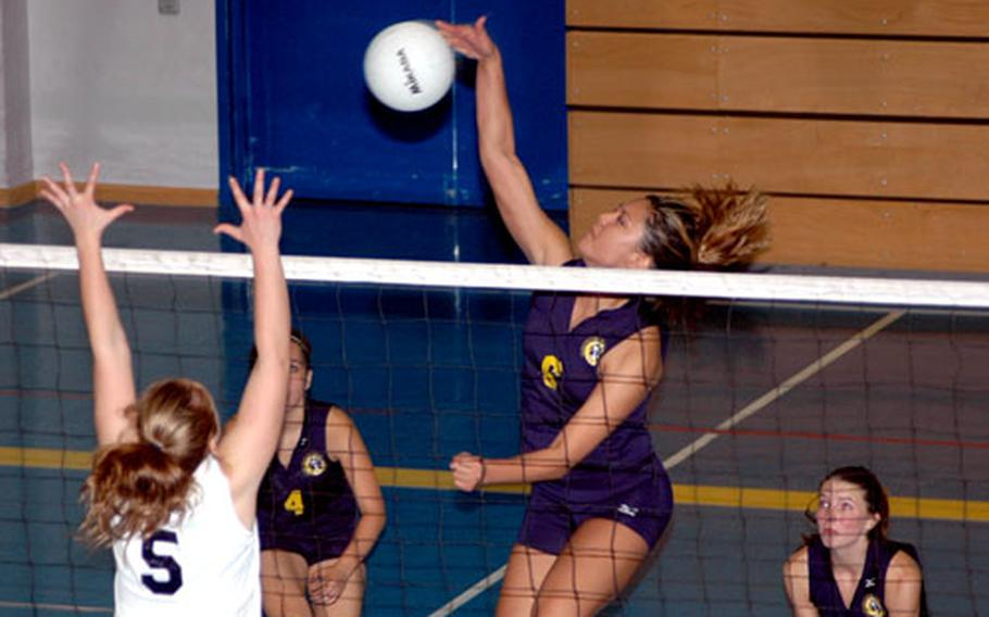 Heidelberg senior Natasha Holan rises high above the net for a spike in a recent game. Holan and the Lady Lions enter this weekend's European tournament as the top seed in Division I.