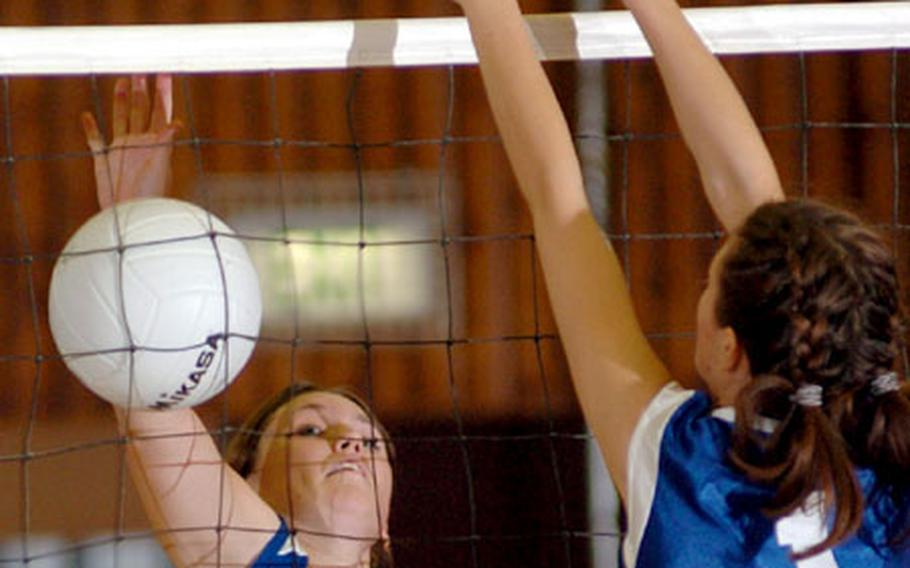 Lajes' Colleen Koonst, left, attempts a spike against Brussels' Viktorija Juciute during a quarterfinal game of the DODDS Europe volleyball championships in Kaiserslautern, Germany, on Friday. Lajes defeated Brussels 25-22, 20-25, 15-10 to advance to the semifinals against Milan.
