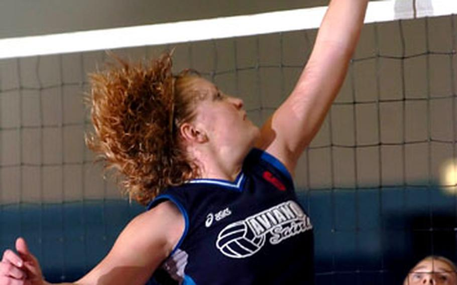 Raymond T. Conway / S&S Aviano's Jessica Corder hits an attempt against Black Forest Academy during the championship game of the DODDS-Europe Division II volleyball final in Ramstein, Germany, on Saturday. Aviano defeated BFA 25-23, 25-7, 25-8 to win the title.