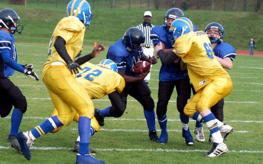 Brandon Merriweather of Hohenfels breaks through the Ansbach defense for a touchdown on Saturday.