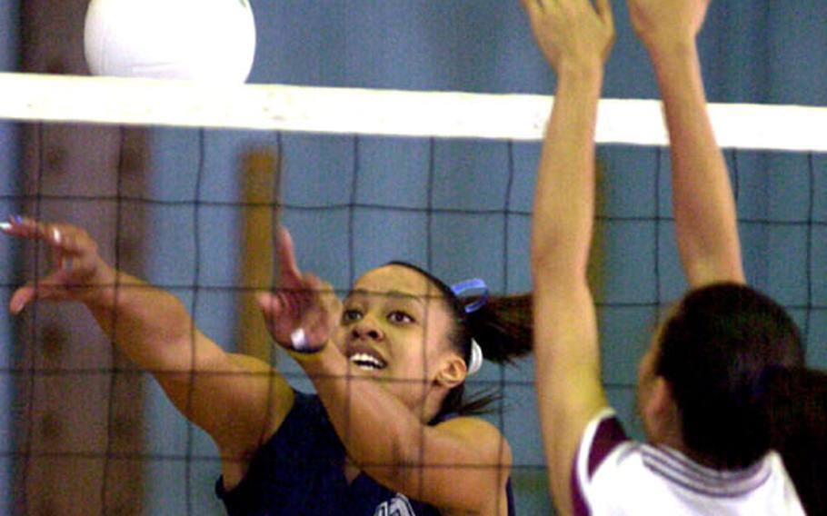 Seoul American middle blocker Margaret Nurse (13) pushes the ball past the block of Seisen International defender Jessica Eastling (6) during Wednesday's divisional play in the 2005 Far East High School Girls Class AA (large schools) Volleyball Tournament at Yongsan Garrison.