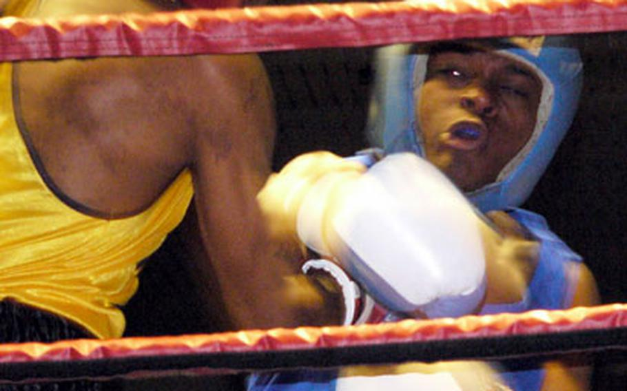 Middleweight Carlos Wright, right, throws a straight right at fellow infantryman Keeon Britton during Britton's 2-1 victory Saturday night.