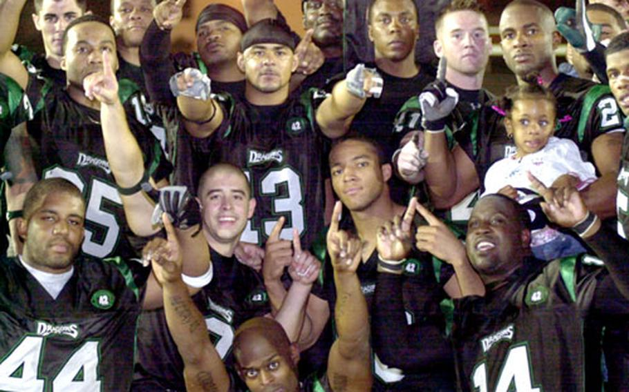 Kadena Dragons players celebrate their second straight Okinawa Football League championship Saturday at Camp Foster, Okinawa. The Dragons romped 45-7 over the Courtney-Hansen Titans.