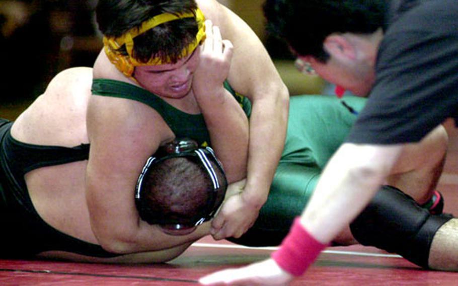 "David Leh of Robert D. Edgren pins David Miller of Kubasaki in 3 minutes, 50 seconds in Saturday's 215-pound semifinal bout in the ""Beast of the Far East"" Wrestling Tournament at Nile C. Kinnick High School, Yokosuka Naval Base, Japan."