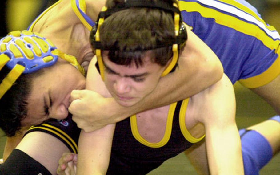 Nick Guzman of the Yokota Panthers ties up Chris Lowry of the American School In Japan Mustangs during Wednesday's 108-pound bout.