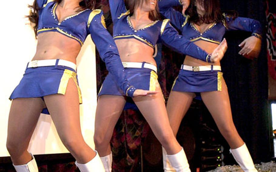 St. Louis Rams cheerleaders, from left, Angeline O'Neal, Erin Donnelly and Emily Halvachs perform a dance during halftime at the Kadena Air Base Rocker NCO club's Super Bowl party Monday morning.